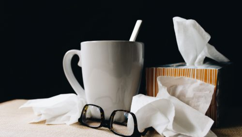 Tissues, tea mug and glasses