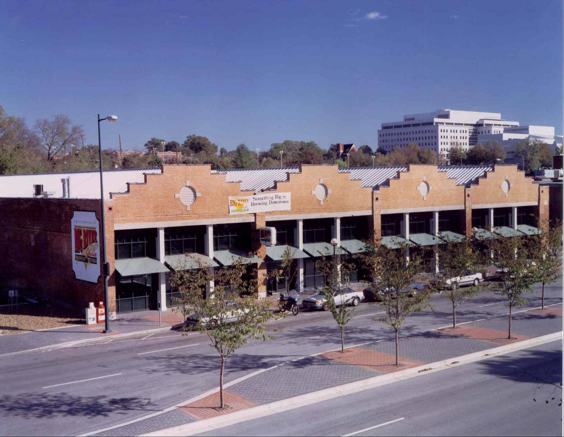 Photo of an old strip of brick buildings.