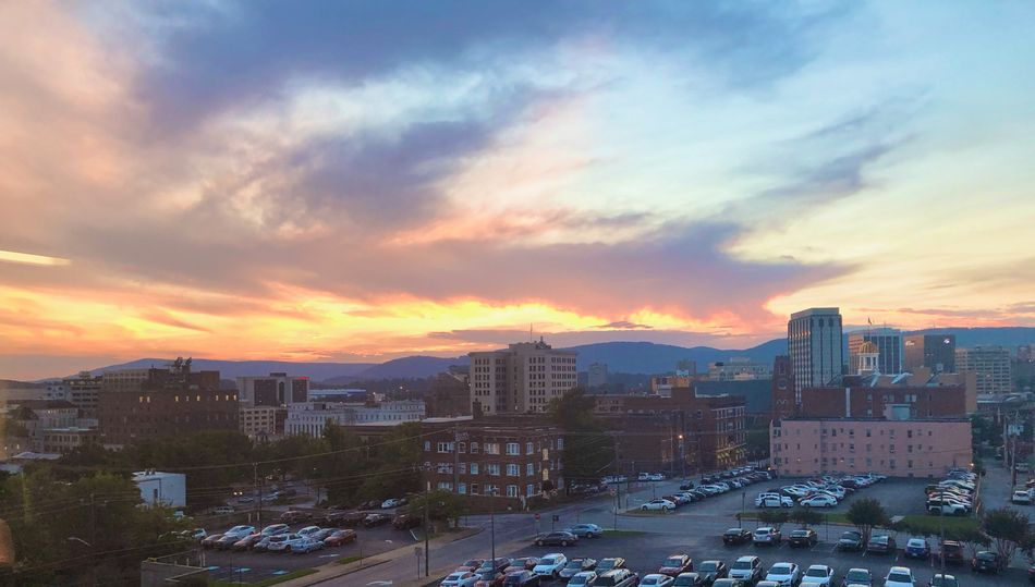 Photo of the Chattanooga skyline and downtown buildings at sunset.