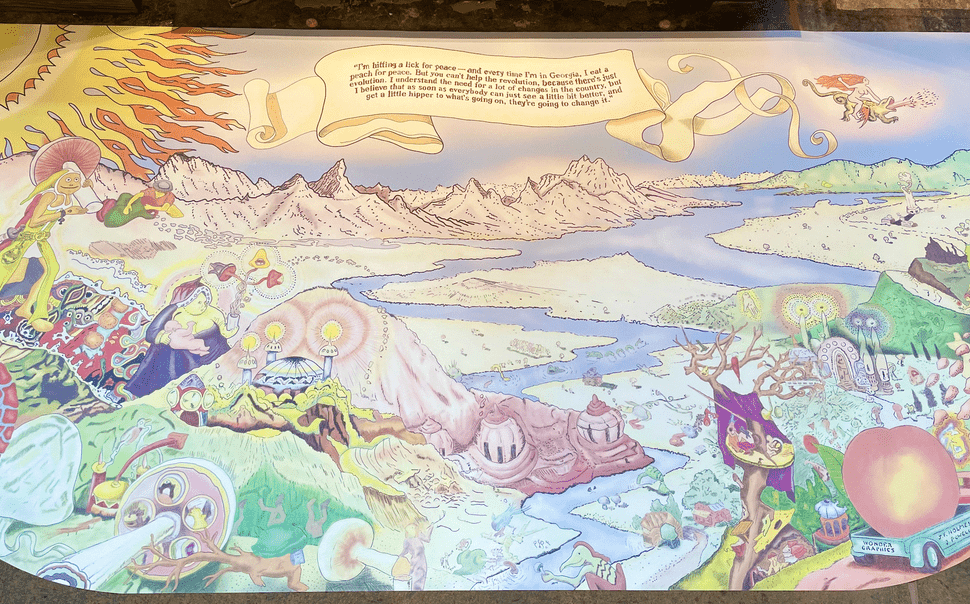 Photo of a large, mural-like artwork display featuring mountains, a river, a large sun in the left corner, a variety of unknown creatures, and a large peach sitting in a truck in the bottom right corner.