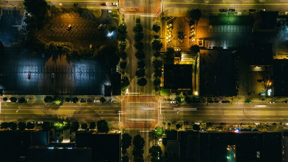 An aerial view image at night of two different street intersections