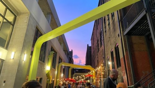 Cooper's Alley at twilight with string lights
